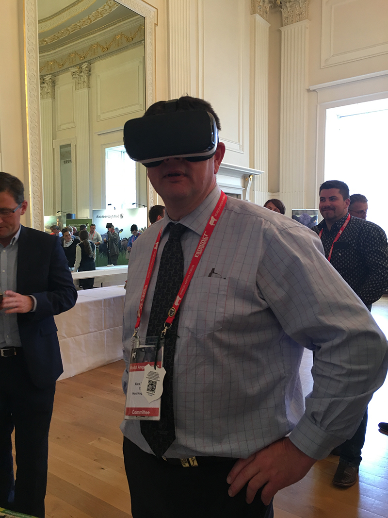 Alex Sanger, World Angus Forum 2017 Chair & Aberdeen-Angus Cattle Society President, using virtual reality goggles to climb the Sydney Harbour Bridge