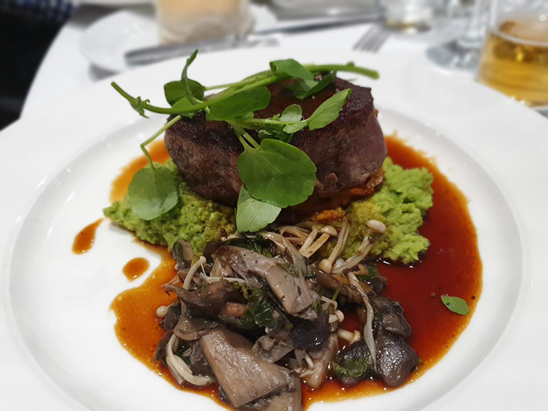 Jack's Creek Black Angus Beef eye fillet with crushed peas, mushroom ragout, Kumara rosti, red current jus and baby watercress