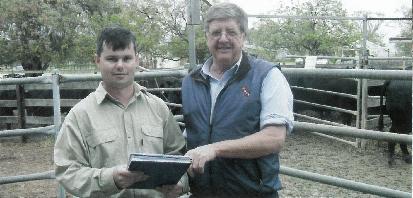 Jason Archer from Trangie Research Station with Warren Nancarrow from New England Artificial Breeders planning AI program for Angus Bull Progeny Test, Australian Angus Journal 2002