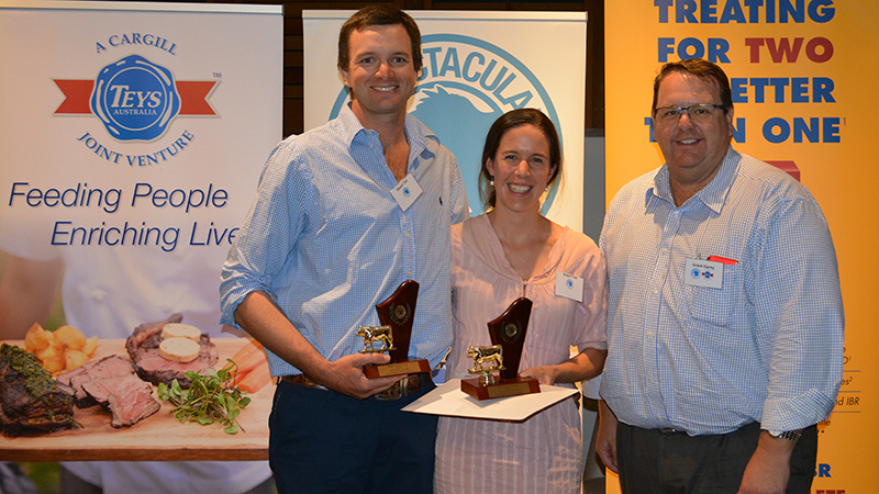 Stuart and Isabel Tait from Tait Pastoral Company, Mandurama, received equal third place with their two teams of Angus steers. Pictured with Teys Australia general manager feedlots Grant Garey.  Image courtesy of The Land